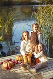 Kids playing near the lake in autumn Royalty Free Stock Photography