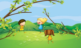 Kids playing near the mountain Stock Photos