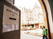 Kids playing near pooling station. STRASBOURG, FRANCE - MAY 7, 2017: Bureau de vote sign in French city with kids playing near pooling place during the second Royalty Free Stock Photo