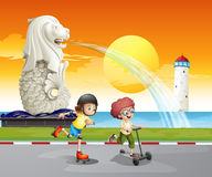 Kids playing near the statue of Merlion Stock Image