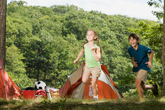 Kids playing near tents Royalty Free Stock Photography