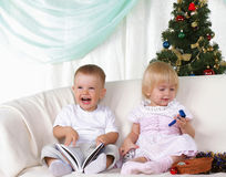 Kids playing near to christmas fur-tree Royalty Free Stock Photography