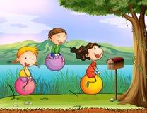 Kids playing near a wooden mailbox Stock Photos