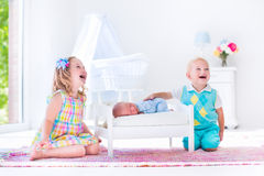 Kids playing with new born baby brother Royalty Free Stock Photo