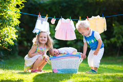 Kids playing with newborn baby brother Stock Image