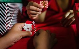 Kids Playing origami paper Santa. Christmas Concept. Kids play on the bed Stock Images