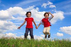 Kids playing outdoor Stock Photos