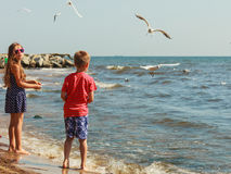 Kids playing outdoor on beach. Royalty Free Stock Image