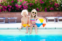 Kids playing at outdoor swimming pool Stock Image