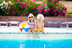Kids playing at outdoor swimming pool Royalty Free Stock Photos