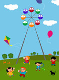 Kids playing outdoors. A vector illustration of happy kids playing outdoors Royalty Free Stock Photos
