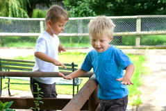 Kids playing outdoors. Stock Images