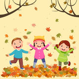 Kids playing outdoors in autumn Royalty Free Stock Photography
