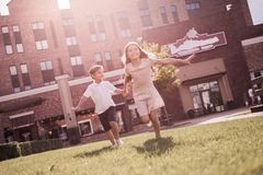 Kids playing outdoors Stock Image