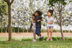 Kids playing outdoors with friends stock photos