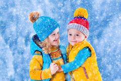 Kids playing outdoors in winter Royalty Free Stock Photos