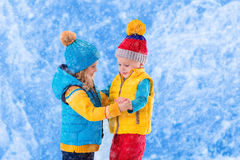 Kids playing outdoors in winter Stock Image
