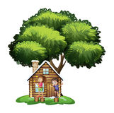 Kids playing outside the house under the tree Royalty Free Stock Photography