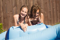 Kids playing outside in summer Royalty Free Stock Photos