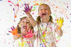 Kids playing in paint. Two kids playing in colorful paint Stock Photo