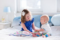 Kids playing on parents bed Royalty Free Stock Images