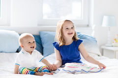 Kids playing on parents bed Royalty Free Stock Photography