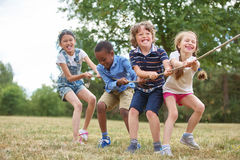 Kids playing at the park. Interracial group of kids playing at the park royalty free stock photography