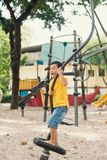 Kids playing with park play equipment.  stock image