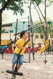 Kids playing with park play equipment.  stock photography