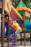 Kids playing with park play equipment.  stock photos
