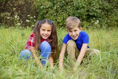 Kids playing in a park. A portrait of happy kids playing in a park Stock Photo