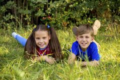Kids playing in a park. A portrait of happy kids playing in a park Royalty Free Stock Photography