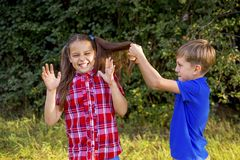 Kids playing in a park. A portrait of happy kids playing in a park Royalty Free Stock Images