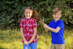 Kids playing in a park. A portrait of happy kids playing in a park Royalty Free Stock Image