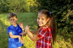 Kids playing in a park. A portrait of happy kids playing in a park Stock Images