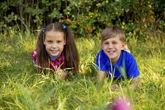 Kids playing in a park. A portrait of happy kids playing in a park Stock Photos