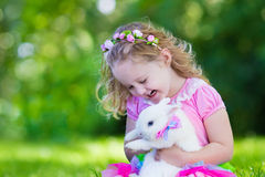 Kids playing with pet rabbit Stock Photos