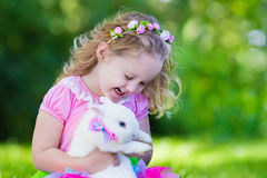 Kids playing with pet rabbit Stock Images