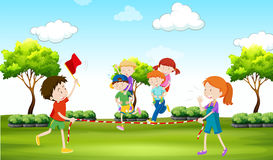 Kids playing piggy back ride in the park Royalty Free Stock Image