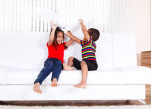 Kids playing with pillows Royalty Free Stock Photography
