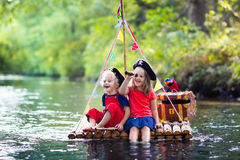Free Kids Playing Pirate Adventure On Wooden Raft Royalty Free Stock Photo - 77274065