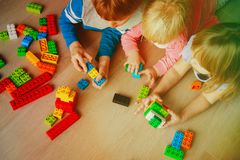 Kids playing with plastic blocks, learning concept. Kids playing with plastic blocks indoors, learning concept Royalty Free Stock Photo