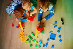 Kids playing with plastic blocks, learning concept stock photos