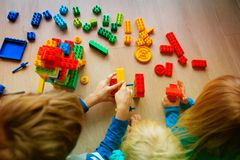 Kids playing with plastic blocks, learning concept Royalty Free Stock Photo