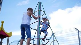 Kids playing on the Playground, go up the stairs. Active outdoor sports stock video footage