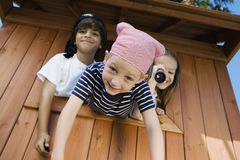 Kids Playing In Playhouse Stock Photos