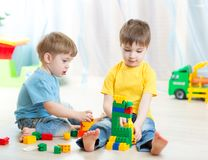 Kids playing in playschool or at home Stock Photography