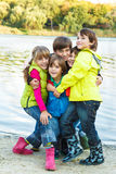 Kids playing beside pond Royalty Free Stock Photos
