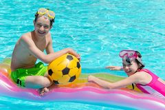 Kids playing in the pool Royalty Free Stock Photos