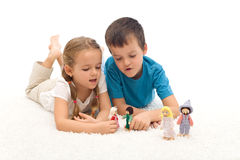 Kids playing with puppets laying on the floor Stock Photos